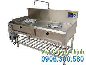 Bếp á công nghiệp inox 2 họng kiềng tô có kệ dưới giá tốt tại Inox Việt Cường Thịnh.