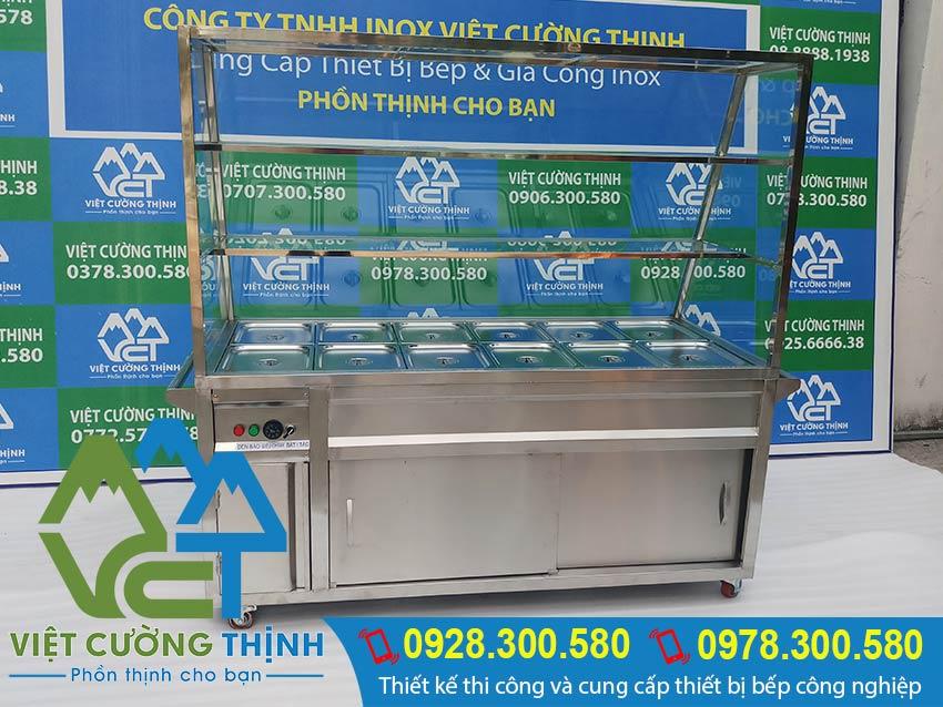 Mẫu tủ giữ nóng thức ăn 12 khay 3 tầng lắp kính cường lực giá tốt tại xưởng sản xuất Inox Việt Cường Thịnh. Mẫu có sẵn hoặc sản xuất đơn đặt hàng của quý khách.